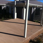 Coloured Concrete Wheelchair Accessible Path Adjacent To Driveway With Aluminium Privacy Fencing