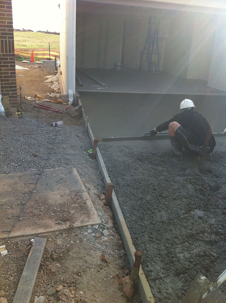 Concretor Hard At Work On Concrete Driveway of a Sydney Granny Flat With Garage