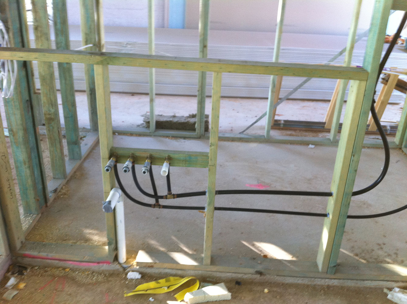 Service Rough-in on Structural Framing with Excess of Clips & Silicone to Eliminate Water Hammer after Sheeting
