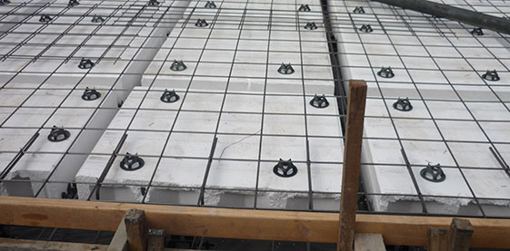 Concrete Slab with Waffle Pods and Steel Reinforcements